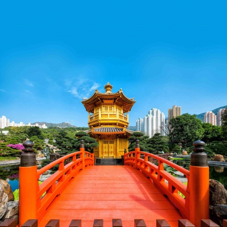 A red bridge in the foreground and leading to the Golden Pagoda in Hong Kong.