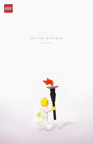 A Lego figure carrying the Olympic torch.