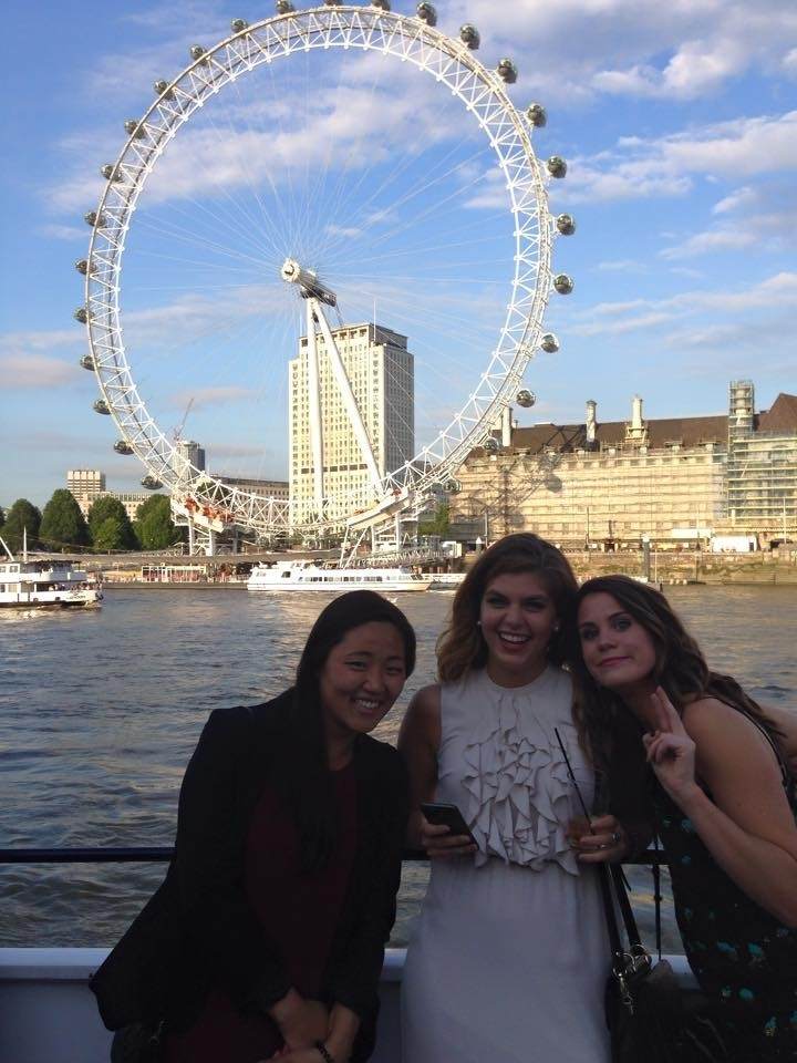Students posing in front of the London Eye.