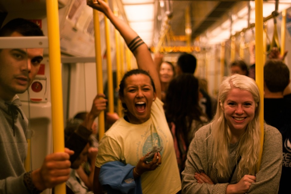 Temple students riding the Tube in London.