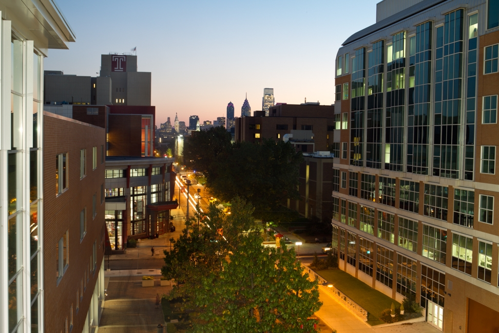 Temple University campus with Philadelphia skyline in background during sunset