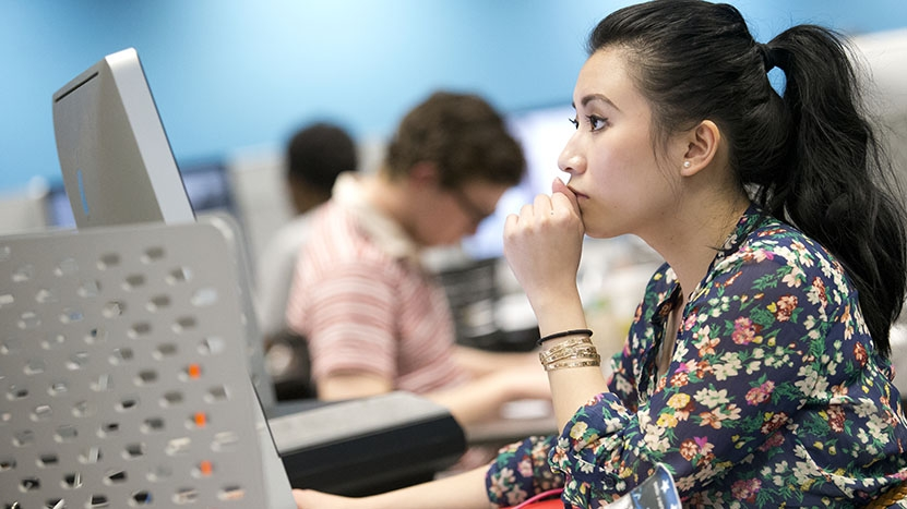 Student sitting at a computer in the TECH Center.
