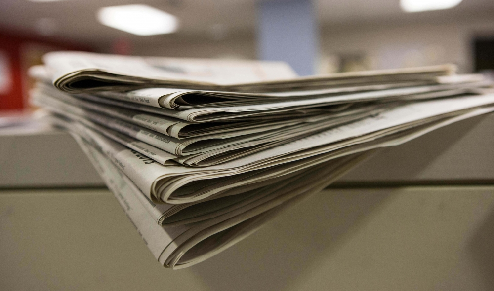 A stack of print editions of The Temple News