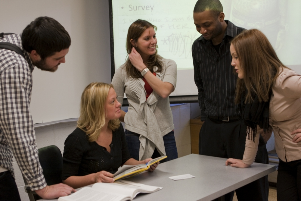 Graduate and undergraduate students meeting in a classroom