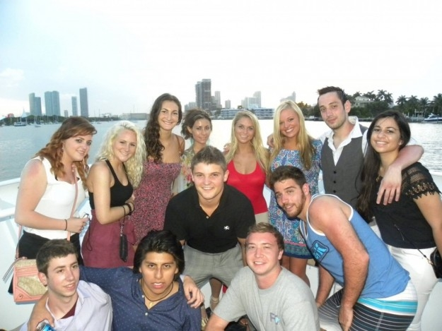 a group of students posing on boat in Miami