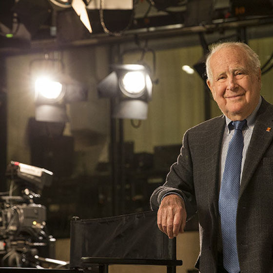 Lew Klein standing in a television studio